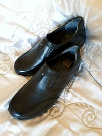 pair of black leather dress shoes Toronto, M2N 1X8