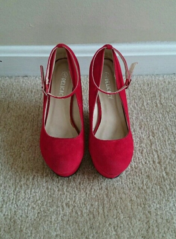 pair of red suede platform shoes