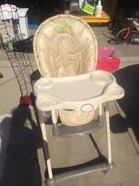 beige padded high chair with tray Edmonton, T5Y 2Y9