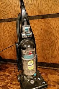 black and gray Bissell upright vacuum cleaner