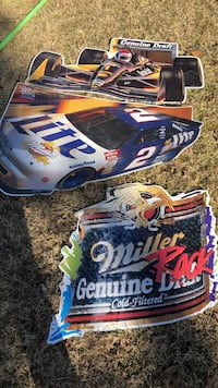 three cars and Miller posters