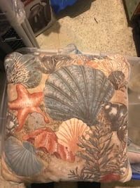 2 different beachy pillows