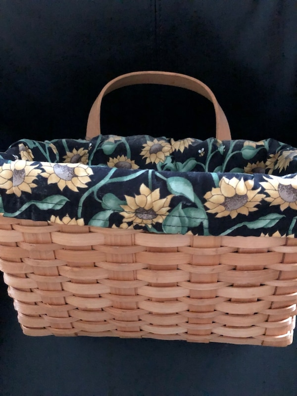 Basket with removable sunflower liner.  11 X 7 X 5
