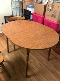 round brown wooden table with four chairs dining set Woodbridge, 22192