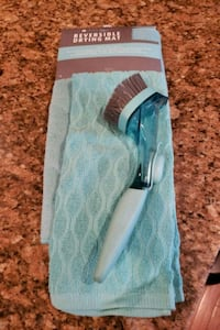 Drying mat/kitchen towel and dish scrubber.