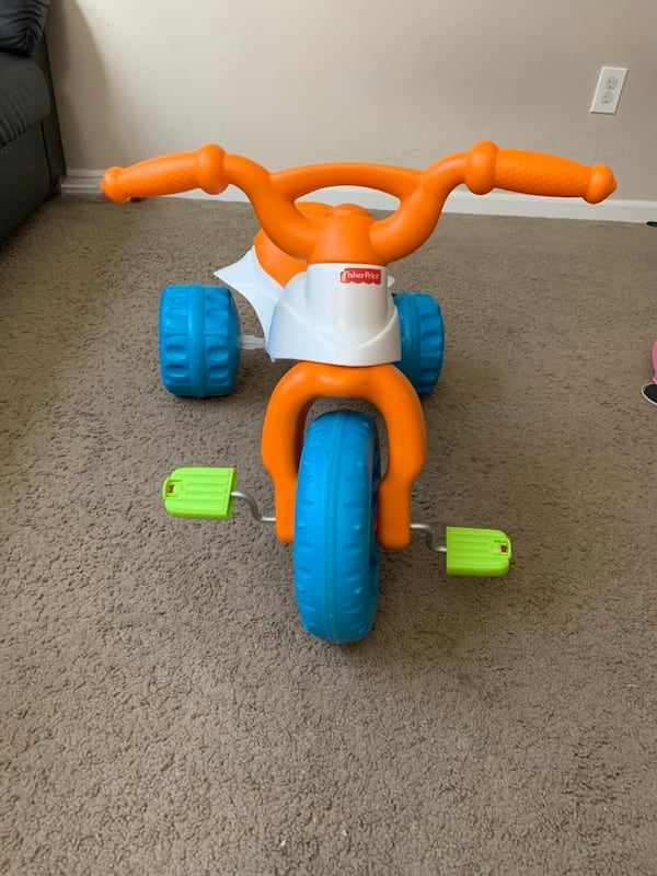 Fisher Price tricycle and baby walker b5f0ee0d-c731-44aa-b1f9-6ec9b50c21e4