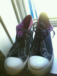 pair of black leather high-top sneakers Winnipeg, R3E 2Z4
