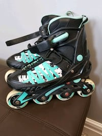 pair of black-and-teal inline skates Sherwood Park, T8H 0L5