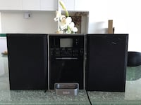 black flat screen TV and black wooden TV stand Vancouver, V6A