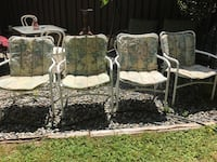 4 light weight patio chairs with cushions. Need wash and then gone  Surrey, V3W 5C3