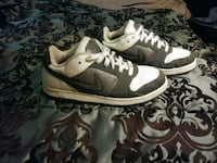 pair of gray-and-white Nike basketball shoes Omaha, 68108