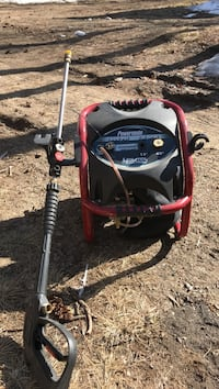 Red and black Powermate pressure washer 461 mi