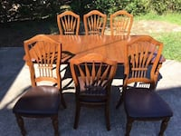 Hardwood table, and six and chairs. Homosassa, 34448
