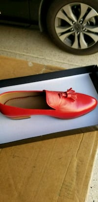 unpaired red leather loafer