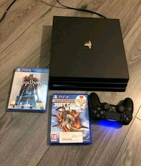 black Sony PS4 console with controller and game ca Glenwood, 51534