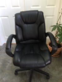 Executive Bonded Black leather padded office rolling armchair
