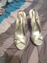 pair of gold-colored open-toe slingback heels