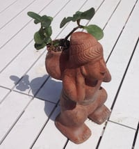 Authentic Inca man carrying pack with plant Los Angeles