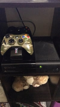 Xbox 360 controllers (one controller is limited edition), charging stand and console. Clinton, 84015