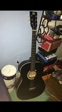 Black and brown acoustic guitar Rockville, 20853