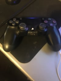 PS4 with one controller and a headset. Utica, 13502