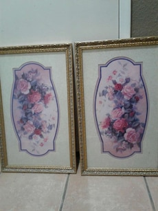 two square brown wooden framed petal flower paintings