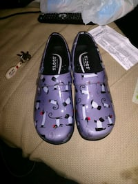 pair of purple-and-white slip on nurse shoes Cleveland, 37311