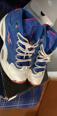 pair of blue-and-white Nike basketball shoes 157 mi