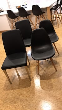two black leather padded chairs