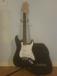 Academy electric guitar with worn case