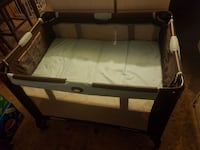 brown and white travel cot 736 mi