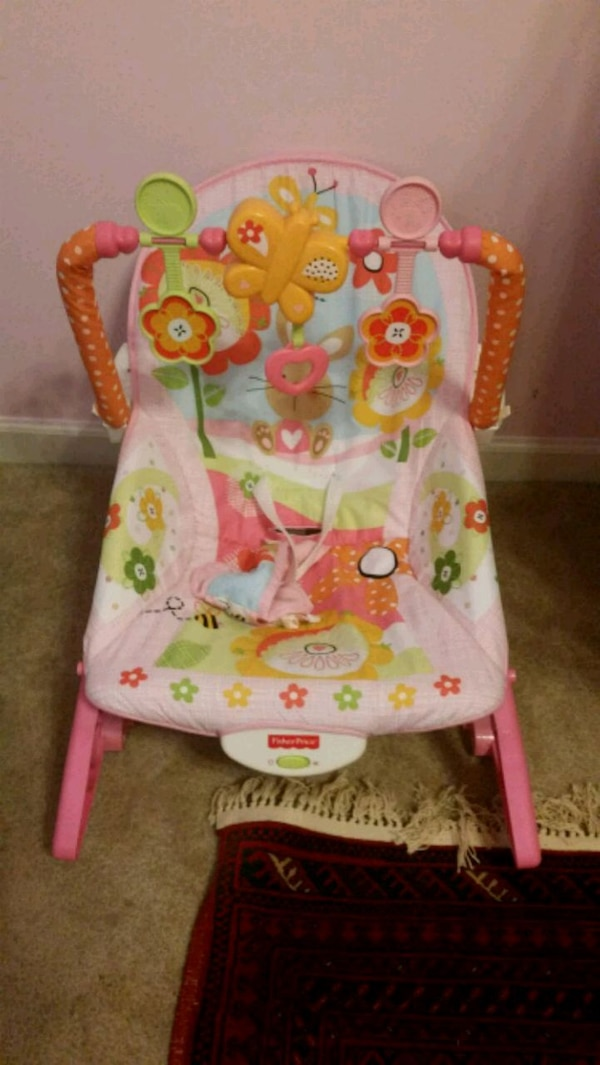 baby's pink and white Fisher Price bouncer