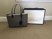 Gray and black gucci leather reversible shoulder bag