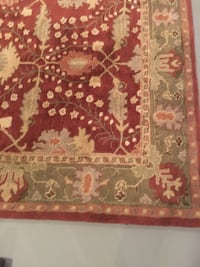 red, white, and brown floral area rug 308 mi