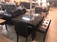 rectangular black wooden table with six chairs dining set Houston, 77095