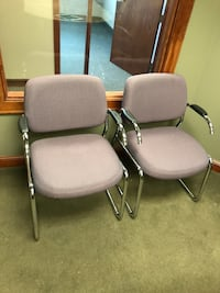Five gray metal framed gray padded armchairs Arden Hills