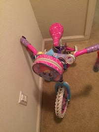toddler's pink and purple bicycle 2389 mi