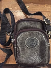 Brand new Roots leather camera bag