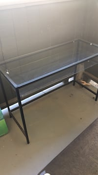 rectangular clear glass top table with black metal base
