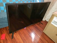 black flat screen TV with remote Moreno Valley, 92553
