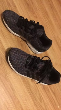pair of black Adidas low-top sneakers Palm Bay, 32907