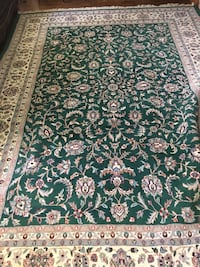 Green, white, and brown floral area rug Washington, 20024