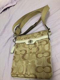 Authentic coach gold cross body  Vancouver, V5T 3H7