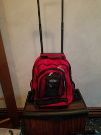 New Olympia Sports Plus Rolling Backpack  North Andover