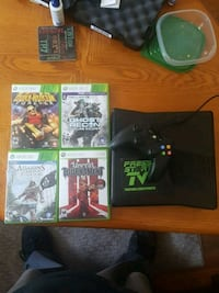 Xbox 360  with 4 games + hdmi cable Winchester, 22601