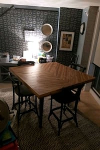 Square counter high dining table with stools