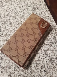 monogrammed brown Gucci leather long wallet