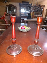 two red and black candle holders 41 km