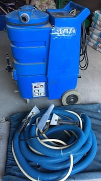 brown Ninja pressure washer and hose