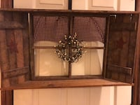 A lovely primitive window with shutters has stars on the shutters a pip berries wreath and curtains hanging a really beautiful addition to your primitive home  Fallston, 21047